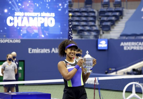 epa08665473 Naomi Osaka of Japan celebrates with the Championship Trophy after defeating Victoria Azarenka to win the Women's Final match on the thirteenth day of the US Open Tennis Championships the USTA National Tennis Center in Flushing Meadows, New York, USA, 12 September 2020. Due to the coronavirus pandemic, the US Open is being played without fans and runs from 31 August through 13 September.  EPA-EFE/JASON SZENES