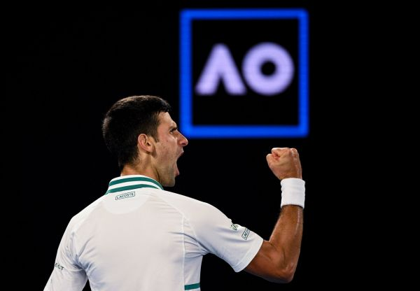 epa09027370 Novak Djokovic of Serbia reacts during his Men's singles finals match against Daniil Medvedev of Russia on Day 14 of the Australian Open Grand Slam tennis tournament at Melbourne Park in Melbourne, Australia, 21 February 2021.  EPA-EFE/DEAN LEWINS AUSTRALIA AND NEW ZEALAND OUT
