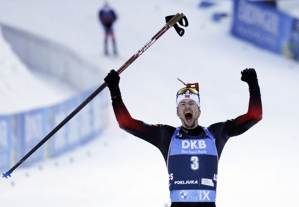 epa09028076 Sturla Holm Laegreid of Norway celebrates after crossing the finish line to win the Men's 15km Mass Start event at the IBU Biathlon World Championships in Pokljuka, Slovenia, 21 February 2021.  EPA-EFE/ANTONIO BAT