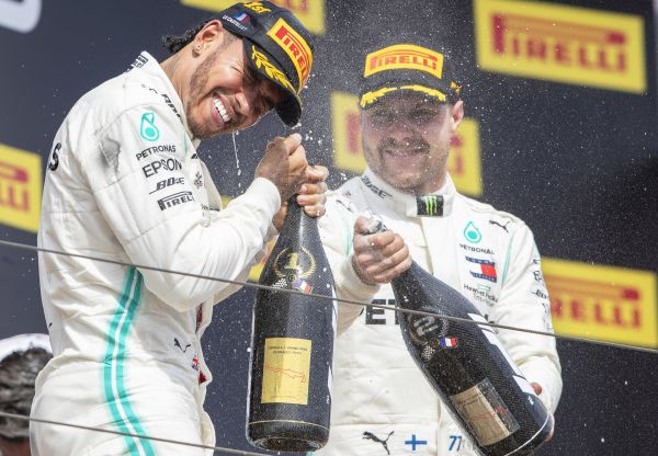 epa07668381 British Formula One driver Lewis Hamilton (L) of Mercedes AMG GP celebrates with his second placed Finnish teammate Valtteri Bottas (R) on the podium after winning the 2019 French Formula One Grand Prix at Paul Ricard circuit in Le Castellet, France, 23 June 2019.  EPA-EFE/VALDRIN XHEMAJ