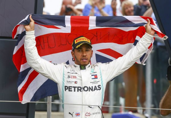 epa07716923 British Formula One driver Lewis Hamilton of Mercedes AMG GP celebrates winning the Formula One Grand Prix of Great Britain at the Silverstone circuit, in Northamptonshire, Britain, 14 July 2019.  EPA-EFE/GEOFF CADDICK