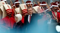 epa04776234 Turkish President Recep Tayyip Erdogan (C) and his wife Emine (L) greet supporters during a rally marking the 562nd anniversary of the conquest of Istanbul by the Ottomans, in Istanbul, Turkey, 30 May 2015. The capital of the Byzantine empire,