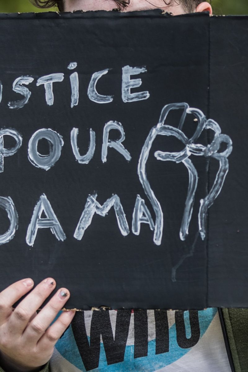 epa08470153 A protester holds up a placard reading in French: 'Justice for Adama' during an anti-racism demonstration on the Champ de Mars (near the Eiffel Tower) in Paris, France, 06 June 2020. The protest was held to condemn the recent killing of George Floyd, a 46-year-old African-American man who died on 25 May after an arresting police officer knelt on his neck for several minutes in Minneapolis (Minnesota), USA, as well as the 2016 death of Adama Traore, a 24-year-old Malian French man who died under custody in a police vehicle after being pinned to the ground by three National Gendarmerie officers.  EPA-EFE/MOHAMMED BADRA